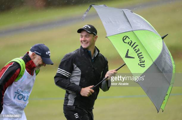 Ben Stow of England walks off the 1st tee with his caddie during day 4 of the Challenge Tour Grand Final at Club de Golf Alcanada on November 10 2019...