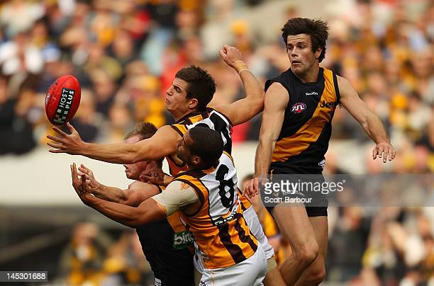 Ben Stratton and Josh Gibson of the Hawks compete for the ball during the round nine AFL match between the Richmond Tigers and the Hawthorn Hawks at...