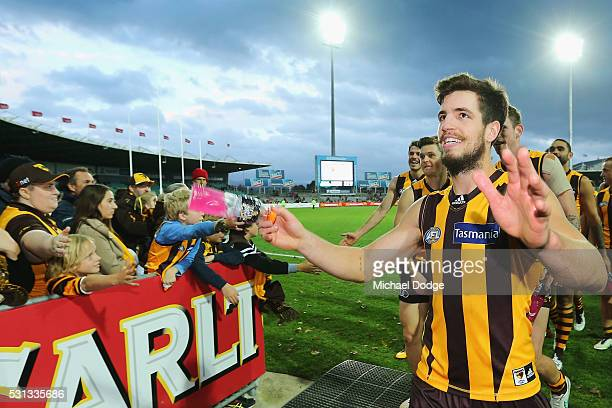 Ben Stratton of the Hawks celebrates the win with fans during the round eight AFL match between the Hawthorn Hawks and the Fremantle Dockers at...