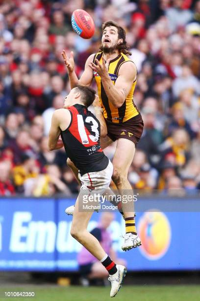 Ben Stratton of the Hawks crucially marks the ball against Orazio Fantasia of the Bombers in the dying stages during the round 20 AFL match between...