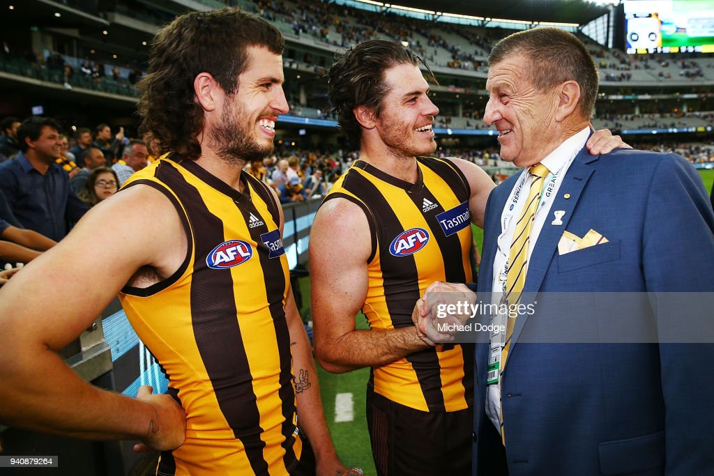 Ben Stratton of the Hawks (L) Isaac Smith celebrate the win Hawks President Jeff Kennett during the round two AFL match between the Geelong Cats and the Hawthorn Hawks at Melbourne Cricket Ground on April 2, 2018 in Melbourne, Australia.