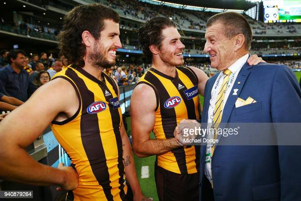 Ben Stratton of the Hawks Isaac Smith celebrate the win Hawks President Jeff Kennett during the round two AFL match between the Geelong Cats and the...