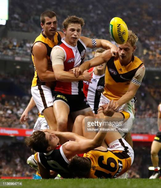 Ben Stratton of the Hawks Jack Billings of the Saints and James Worpel of the Hawks compete for the ball during the 2019 AFL round 04 match between...