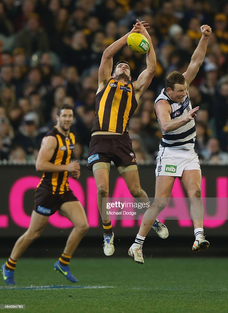 Ben Stratton of the Hawks marks the ball against Steve Johnson of the Cats during the round 20 AFL match between the Geelong Cats and the Hawthorn Hawks at Melbourne Cricket Ground on August 15, 2015 in Melbourne, Australia.