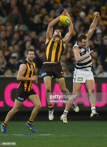 Ben Stratton of the Hawks marks the ball against Steve Johnson of the Cats during the round 20 AFL match between the Geelong Cats and the Hawthorn...