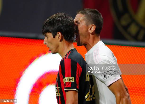 Ben Sweat of Inter Miami reacts towards Jürgen Damm of Atlanta United after both teams are issued yellow cards in the second half of an MLS match at...
