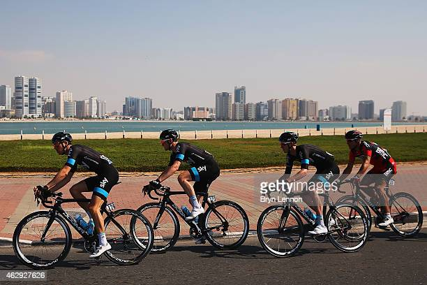 Ben Swift of Great Britain and Team SKY leads team mates Andrew Fenn of Great Britain and Ian Boswell of The USA on stage four of the Dubai Tour from...