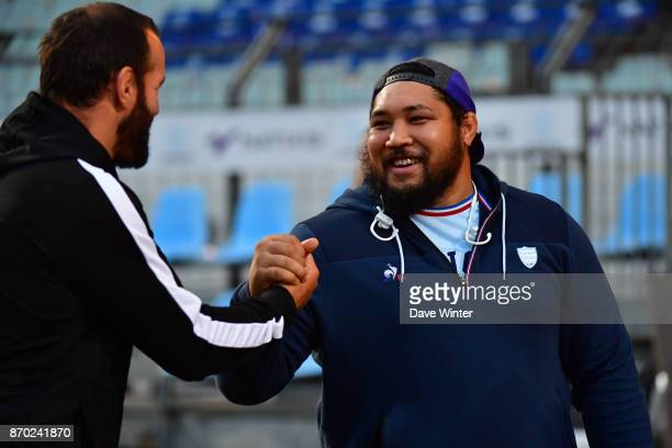 Ben Tameifuna of Racing 92 and Pau forwards coach Carl Hayman during the French Top 14 match between Racing 92 and Pau at Stade Yves Du Manoir on...