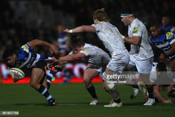 Ben Tapuai of Bath is held up by Jack Singleton of Worcester during the Aviva Premiership match between Worcester Warriors and Bath Rugby at Sixways...