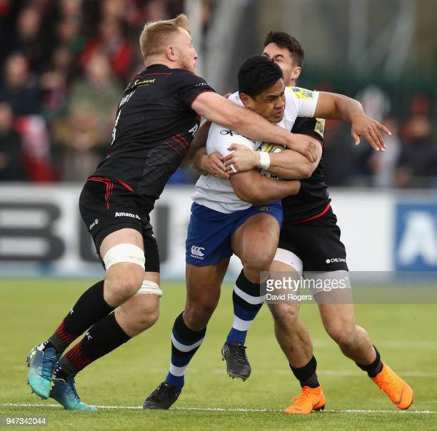 Ben Tapuai of Bath is tackled by Jackson Wray and Sean Maitland during the Aviva Premiership match between Saracens and Bath Rugby at Allianz Park on...