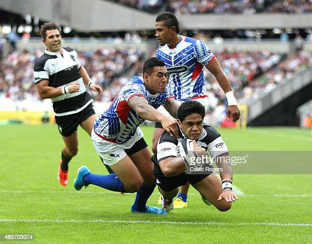 Ben Tapuai of the Barbarians dives over for a try during the Rugby Union match between the Barbarians and Samoa at the Olympic Stadium on August 29...