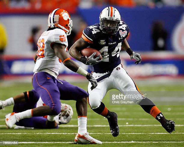 Ben Tate of the Auburn University Tigers runs against Chris Chancellor of the Clemson University Tigers during the ChickFilA Bowl on December 31 2007...