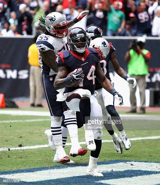 Ben Tate of the Houston Texans scores on a 20 yard run in the second quarter as beats Brandon Spikes of the New England Patriots to the endzone at...