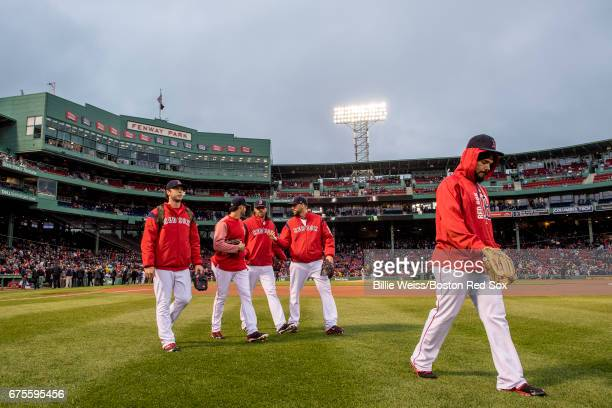 Ben Taylor Joe Kelly Heath Hembree Matt Barnes and Robby Scott of the Boston Red Sox walk toward the bullpen before a game against the Baltimore...