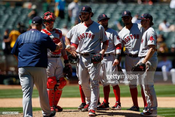 Ben Taylor of the Boston Red Sox is relieved by manager John Farrell during the fifth inning against the Oakland Athletics at the Oakland Coliseum on...