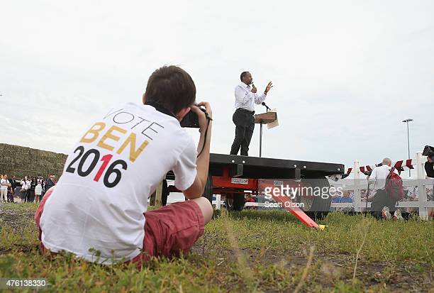 Ben Taylor takes a picture as Republican presidential hopeful Dr Ben Carson speaks at a Roast and Ride event hosted by freshman Senator Joni Ernst on...