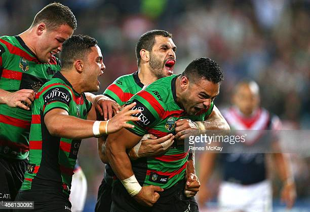 Ben Te'o celebrates his try with Sam Burgess Dylan Walker and Greg Inglis during the First Preliminary Final match between the South Sydney Rabbitohs...