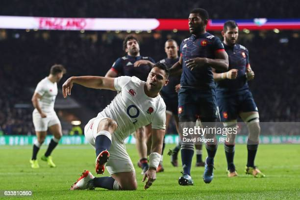 Ben Te'o of England celebrates after scoring his team's first try during the RBS Six Nations match between England and France at Twickenham Stadium...