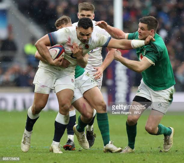 Ben Te'o of England holds off Jonathan Sexton during the NatWest Six Nations match between England and Ireland at Twickenham Stadium on March 17 2018...
