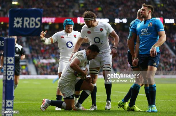 Ben Te'o of England is congratulated by teammates Tom Wood and Jack Nowell after scoring his team's fifth try during the RBS Six Nations match...