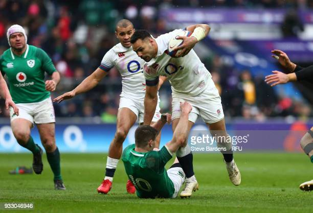 Ben Te'o of England is tackled by Jonathan Sexton of Ireland during the NatWest Six Nations match between England and Ireland at Twickenham Stadium...