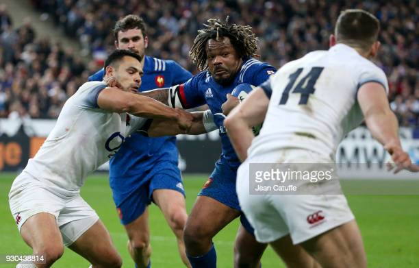 Ben Te'o of England Mathieu Bastareaud of France during the NatWest 6 Nations Crunch match between France and England at Stade de France on March 10...