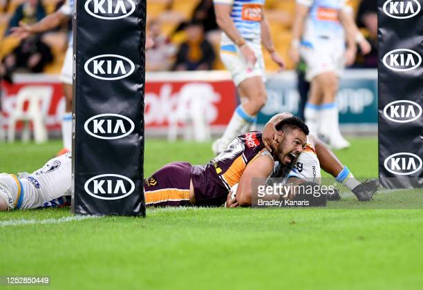 Ben Te'o of the Broncos scores a try during the round seven NRL match between the Brisbane Broncos and the Gold Coast Titans at Suncorp Stadium on...