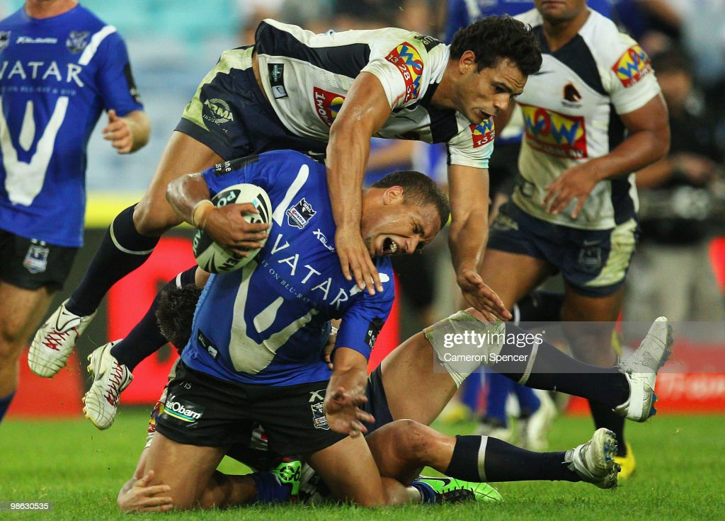 Ben Te'o of the Broncos tackles Yileen Gordon of the Bulldogs during the round seven NRL match between the Canterbury Bulldogs and the Brisbane Broncos at ANZ Stadium on April 23, 2010 in Sydney, Australia.