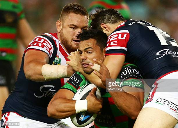 Ben Te'o of the Rabbitohs is tackled during the round one NRL match between the South Sydney Rabbitohs and the Sydney Roosters at ANZ Stadium on...