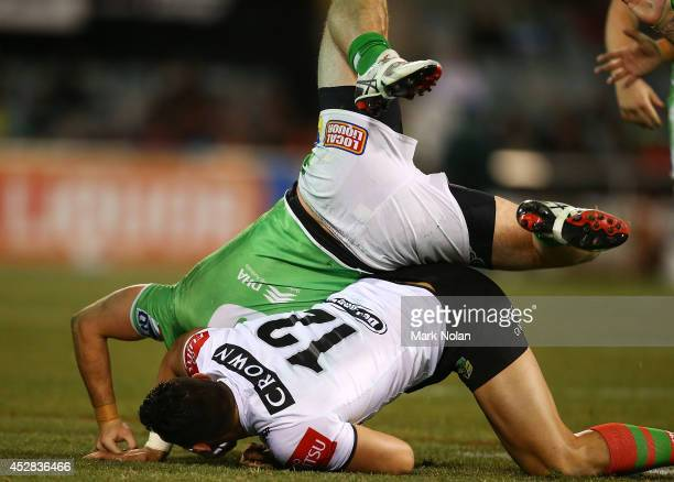 Ben Te'o of the Rabbitohs tackles Jarrod Croker of the Raiders on his head during the round 20 NRL match between the Canberra Raiders and the South...