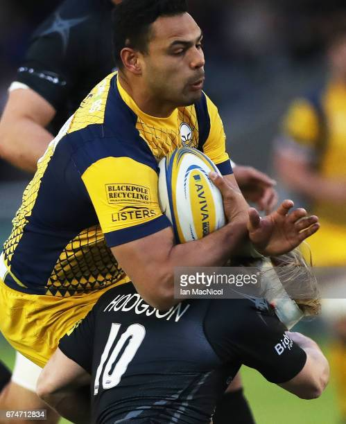 Ben Te'o of Worcester Warriors is tackled by Joel Hodgson of Newcastle Falcons during the Aviva Premiership match between Newcastle Falcons and...
