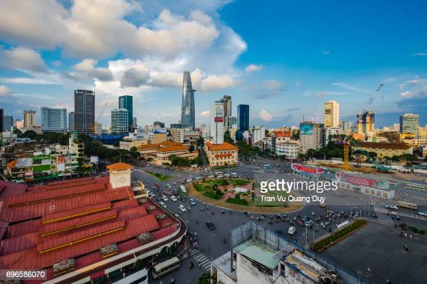 ben thanh market center viewed from above with skyscrapers is gradually shaping the development of active urbanization in ho chi minh city. minh, vietnam - incense coils stock pictures, royalty-free photos & images
