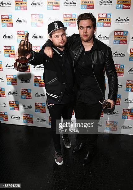 Ben Thatcher and Mike Kerr of Royal Blood pose in the winner's room at the NME Awards at Brixton Academy on February 18 2015 in London England