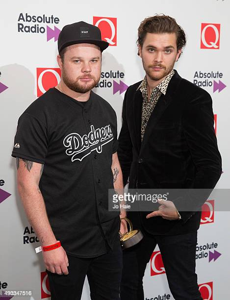 Ben Thatcher and Mike Kerr of Royal Blood pose with Q Best Live Act Award at the Q Awards 2015 at The Grosvenor House Hotel on October 19 2015 in...