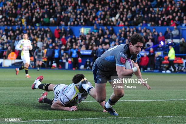 Ben Thomas of Cardiff Blues scores his side's tenth try during the European Challenge Cup Round 6 match between the Cardiff Blues and Rugby Calvisano...