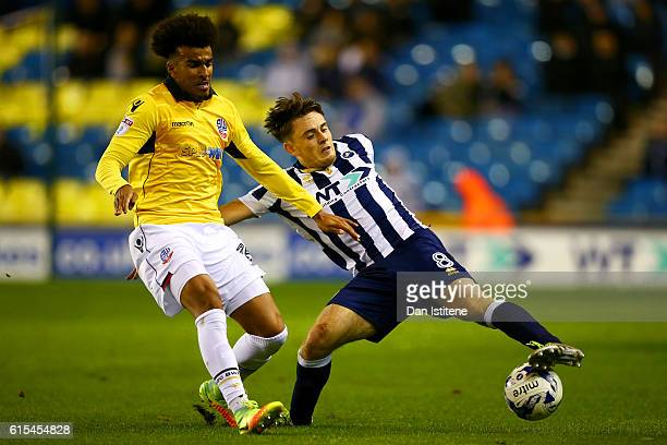 Ben Thompson of Millwall battles for the ball with Derik Osede of Bolton Wanderers during the Sky Bet League One match between Millwall and Bolton...