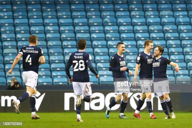 Ben Thompson of Millwall FC celebrates with team-mate with Jon Dadi Boovarsson after scoring his team's third goal during the Sky Bet Championship...