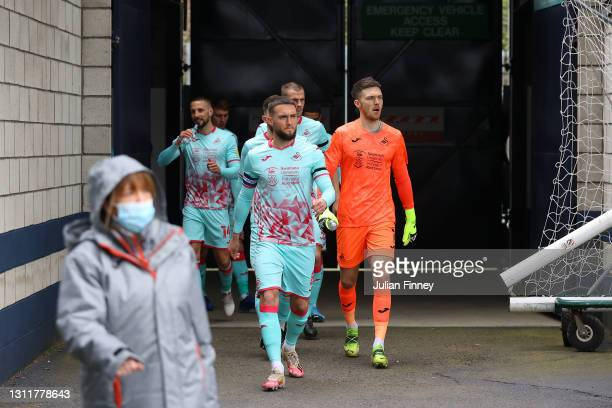 Ben Thompson of Millwall FC leads the team out during the Sky Bet Championship match between Millwall and Swansea City at The Den on April 10, 2021...