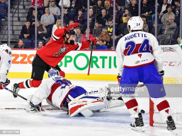 Ben Thomson of the Binghamton Devils scores a first period goal on goaltender Charlie Lindgren of the Laval Rocket during the AHL game at Place Bell...