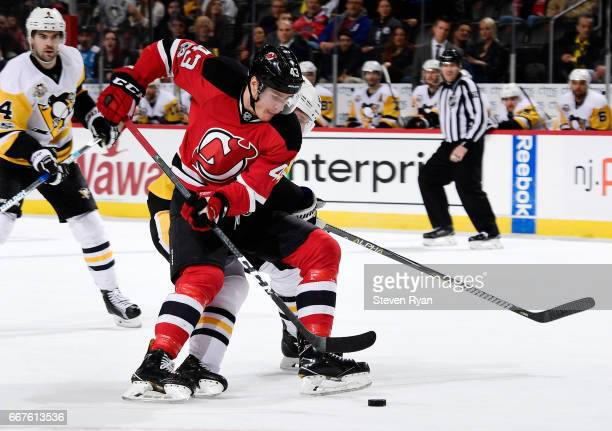 Ben Thomson of the New Jersey Devils handles the puck against the Pittsburgh Penguins during an NHL game at Prudential Center on April 6 2017 in...
