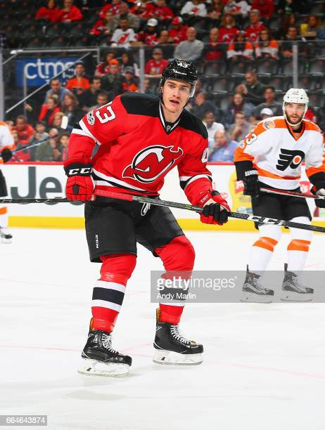 Ben Thomson of the New Jersey Devils playing in his first NHL game skates in the second period against the Philadelphia Flyers during the game at...