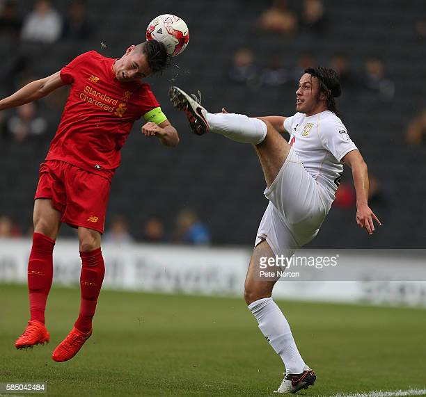 Ben Tilney of MK Dons contests the ball with Adam Phillips of Liverpool U21 during the PreSeason Friendly match between MK Dons and Liverpool U21 at...