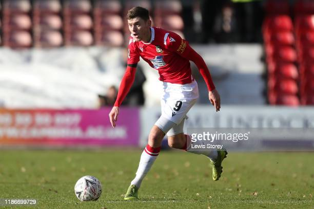 Ben Tollitt of Wrexham in possession during the FA Cup First Round match between Wrexham and Rochdale at Racecourse Ground on November 10 2019 in...