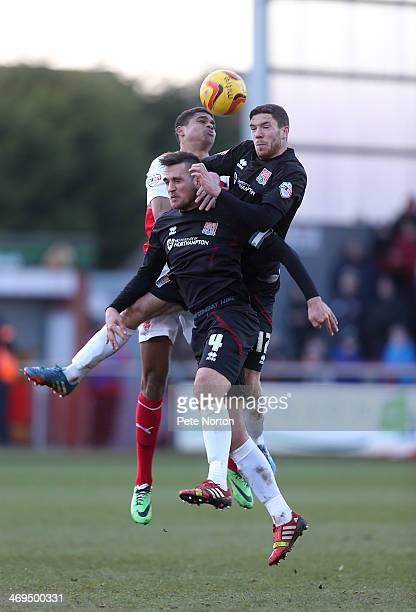 Ben Tozer and Darren Carter of Northampton Town combine to clear the ball from Mikeal Mandron of Fleetwood Townduring the Sky Bet League Two match...