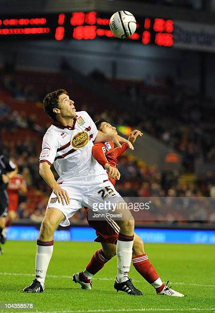 Ben Tozer of Northampton Town tussles with Daniel Pacheco of Liverpool during the Carling Cup 3rd round game between Liverpool and Northampton Town...