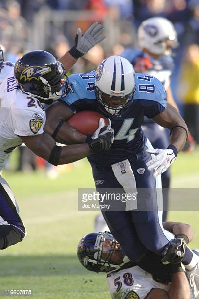 Ben Troupe of the Tennessee Titans against Ed Reed of the Baltimore Ravens against Ben Troupe of the Tennessee Titans during a game between the...