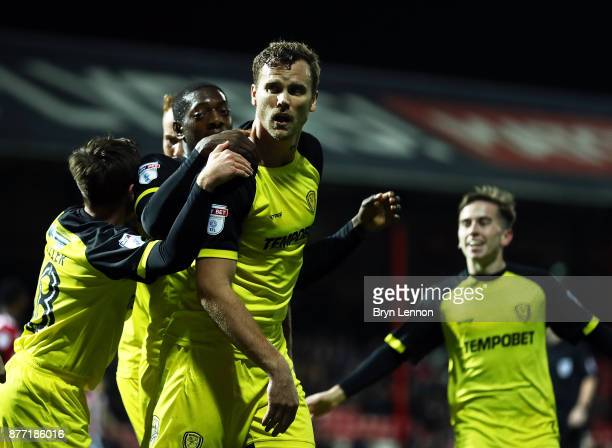 Ben Turner of Burton Albion celebrates with teammates after scoring during the Sky Bet Championship match between Brentford and Burton Albion at...