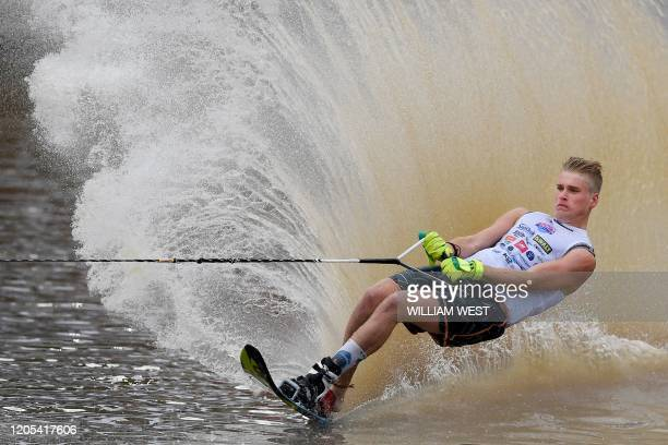 TOPSHOT Ben Turp of Britain competes in the Moomba Masters men's slalom water skiing event on the Yarra River in Melbourne on March 6 2020 / IMAGE...