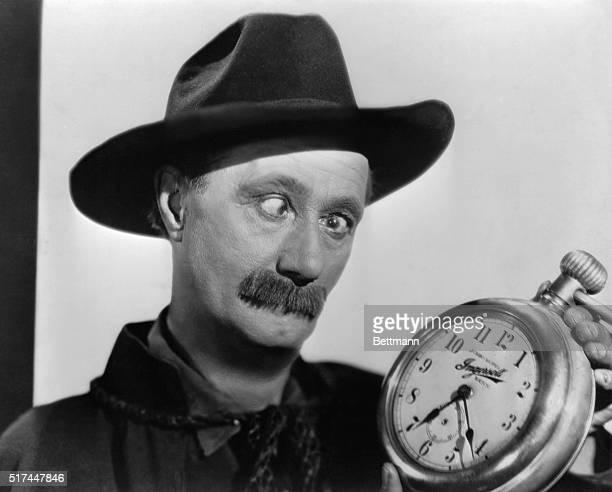 Ben Turpin with an alarm clock