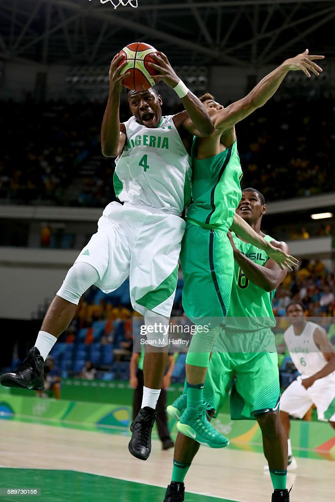 Ben Uzoh #4 of Nigeria rebounds against Raulzinho Neto #5 of Brazil during a Men's Preliminary Pool B match on Day 10 of the Rio 2016 Olympic Games at Carioca Arena 1 on August 15, 2016 in Rio de Janeiro, Brazil.